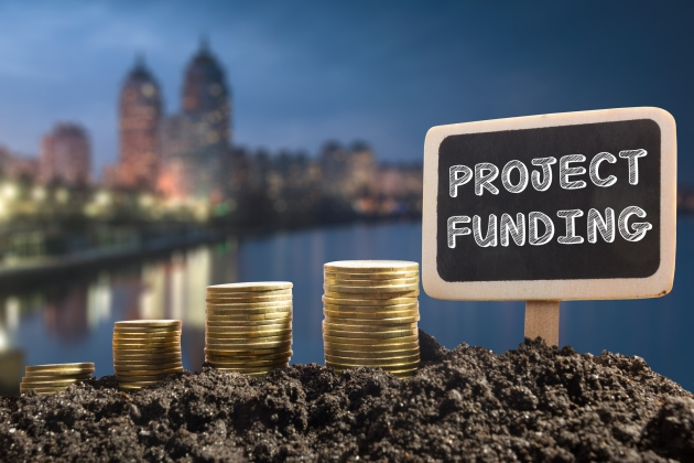 Project funding. Financial opportunity, business and intertnet concept. Golden coins