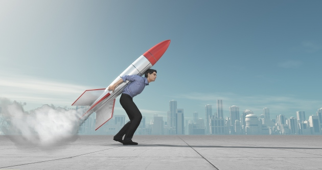Business man with jet pack rocket
