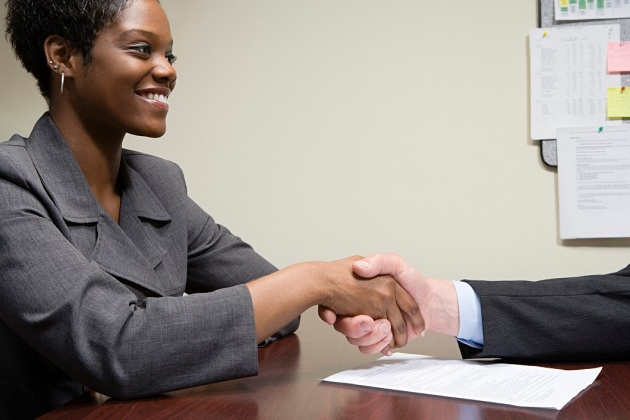 Interviewee and interviewer shaking hands